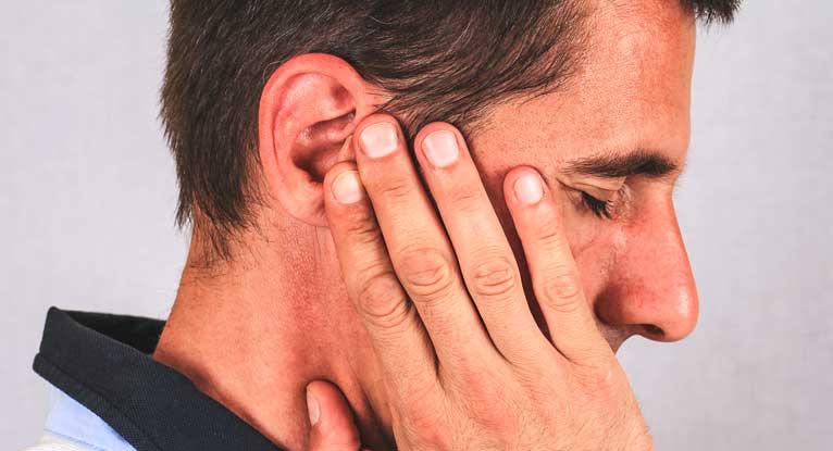 опухоль уха симптомы