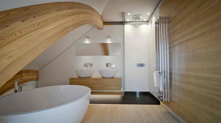 Архитекторы построили стильный дом в форме морской ракушки: панорамный вид на океан только дополняет стилистику здания
