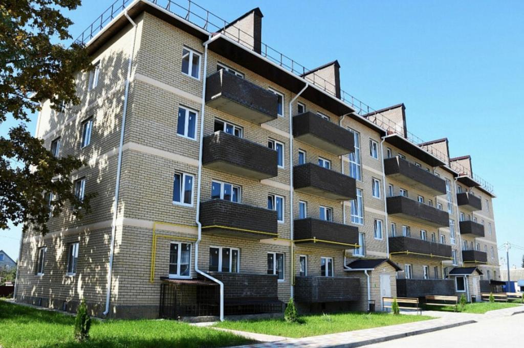 Компенсация за пожар: 20 семей из сгоревшего дома в Краснодаре получили новые квартиры