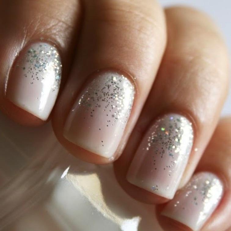 cream manicure with sparkles