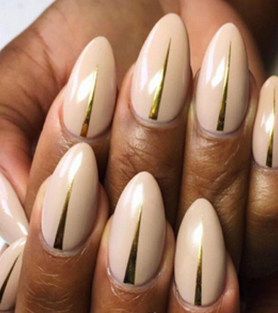cream manicure with chrome inserts