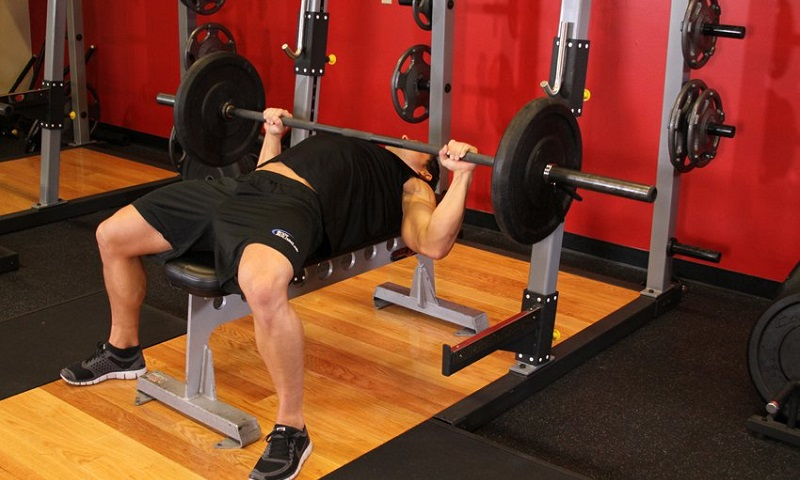 Barbell press by man
