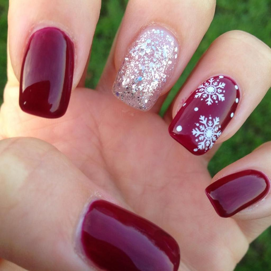 Beautiful manicure with snowflakes
