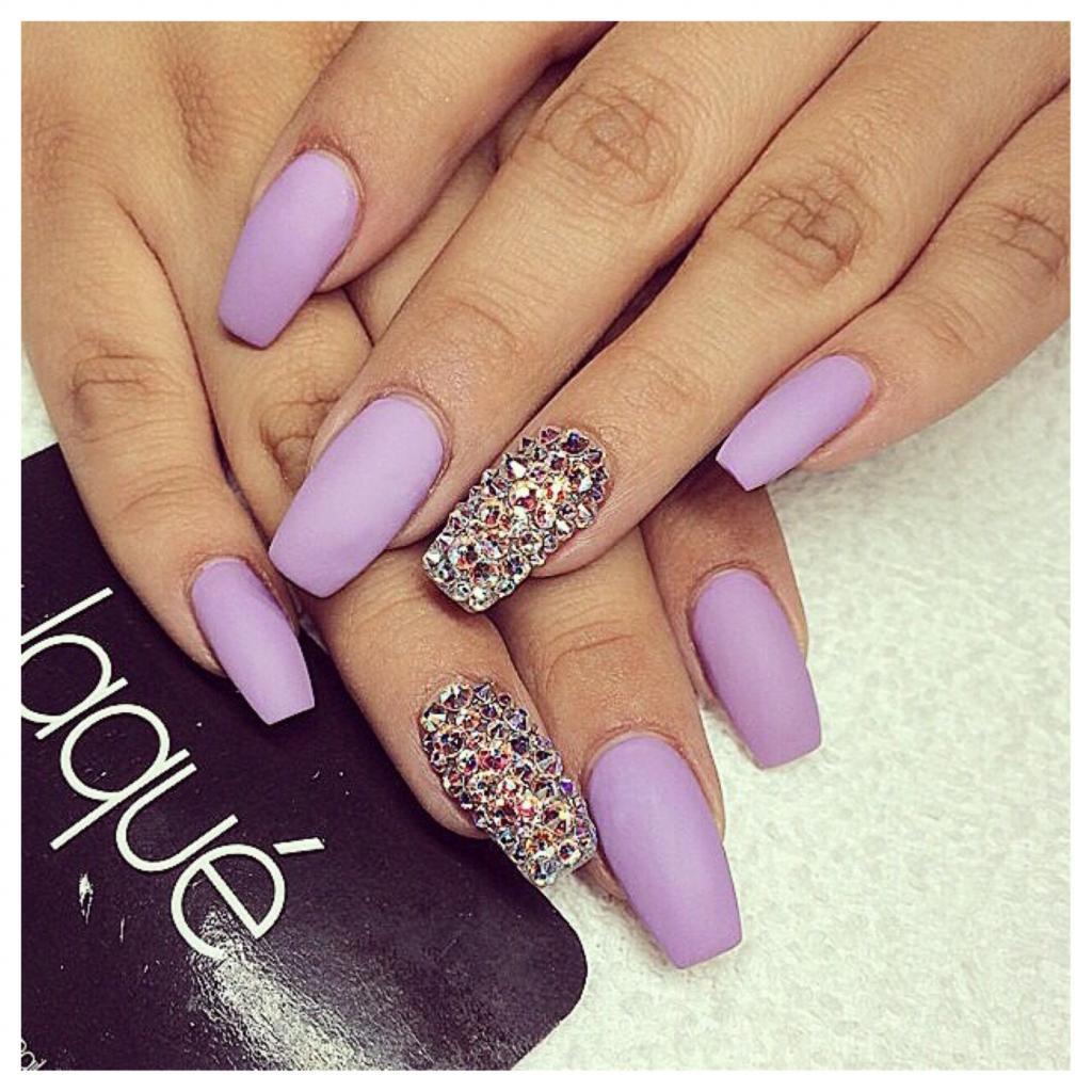 Purple manicure with rhinestones
