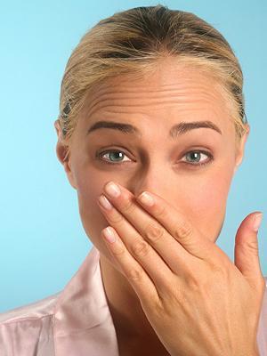 причина неприятного запаха изо рта кошки