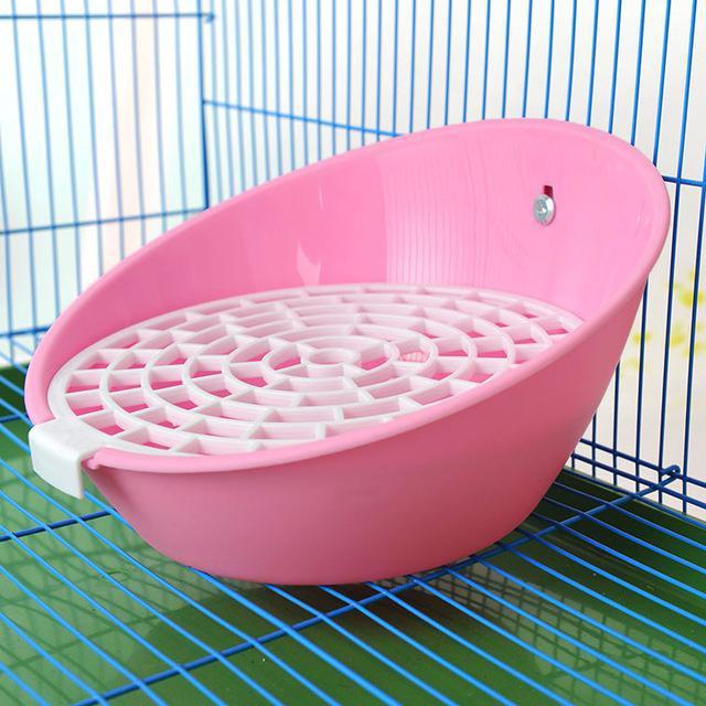 как приучить кролика к лотку в клетке