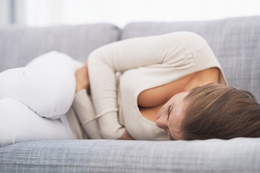 Болит живот за неделю до месячных причины 2