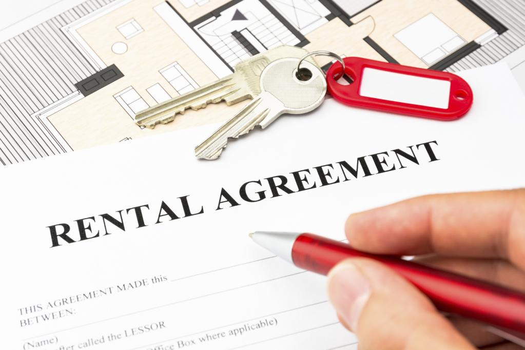 Signing an apartment rental agreement