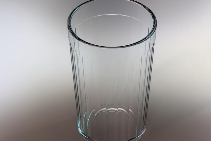 Сахар в граненом стакане