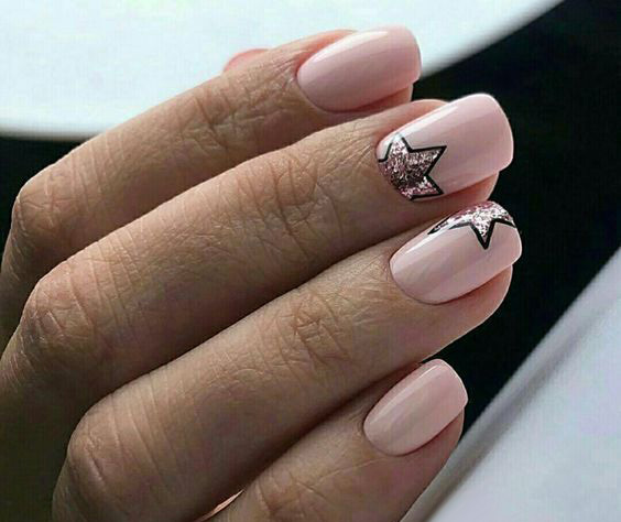 manicure with stars on a pink background