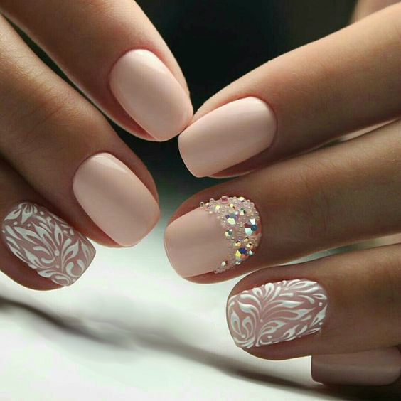white beige manicure rhinestones