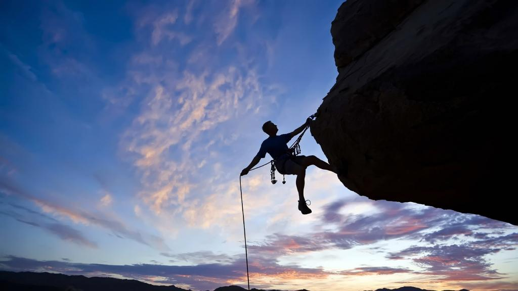 Rock climber conquers the next height.