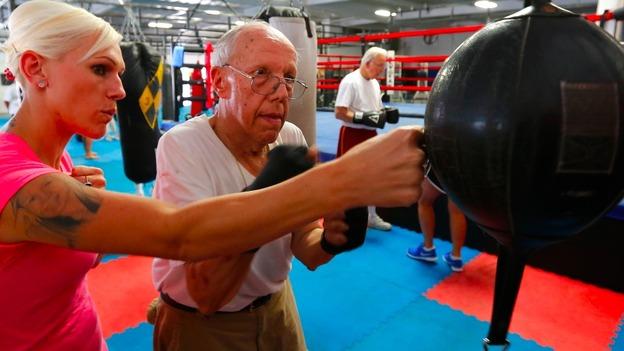 Senior citizen and trainer