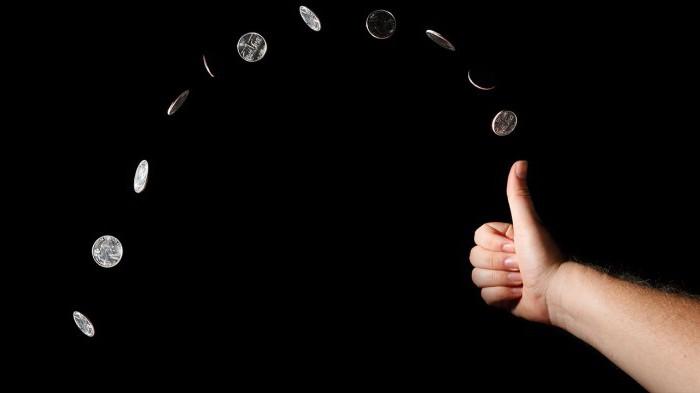 Что такое симметричная монета и где она применяется