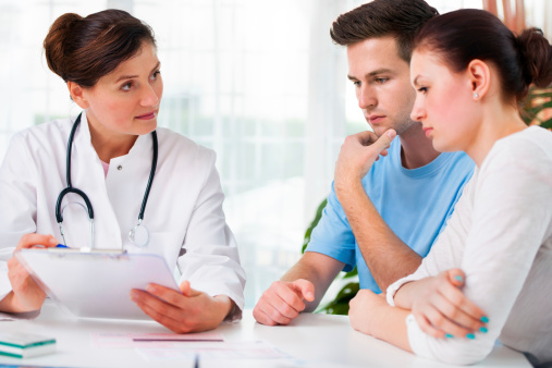 parents talk with a doctor