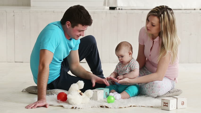 parents play with a child