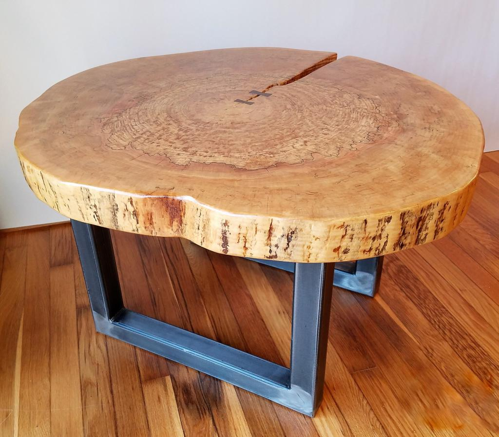 Table made of wood cut on metal frames