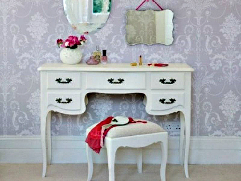 Dressing table with curly details.