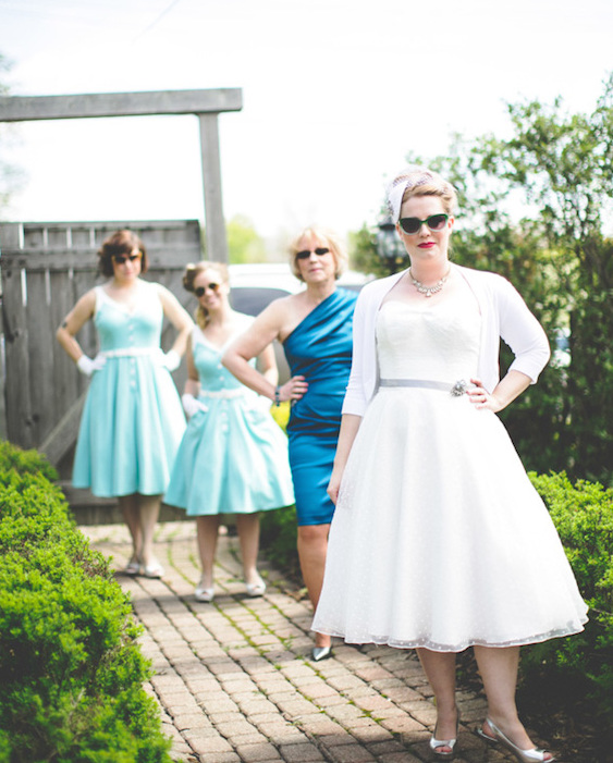 The bride and her friends in colorful dresses