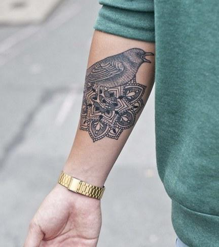 что означает тату птицы на руке