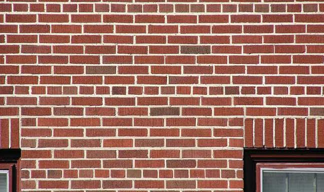 Крепление облицовочного кирпича к несущей стене