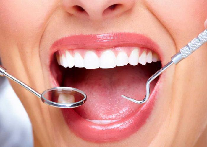 оголилась шейка зуба и болит