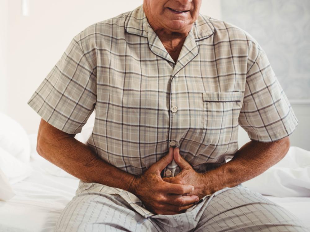 боль в животе ниже пупка у мужчин