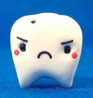Черные точки на зубах у ребенка