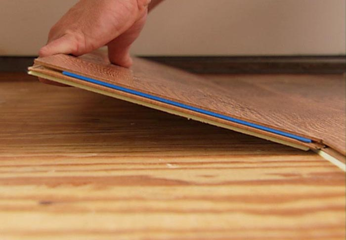 Installation of a laminate with a lock