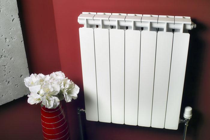 удельная тепловая мощность одной секции алюминиевого радиатора