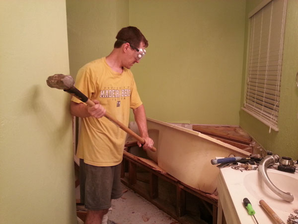Is it possible to break a cast-iron bath with a sledgehammer