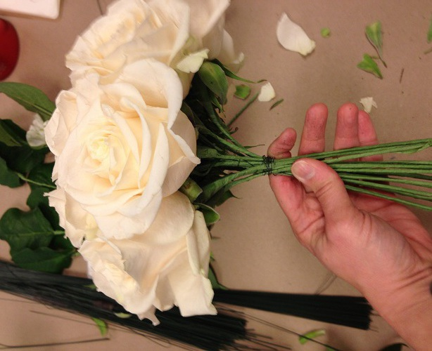 the process of creating a bride's bouquet