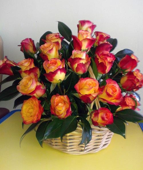 arrangement of garden roses in a basket