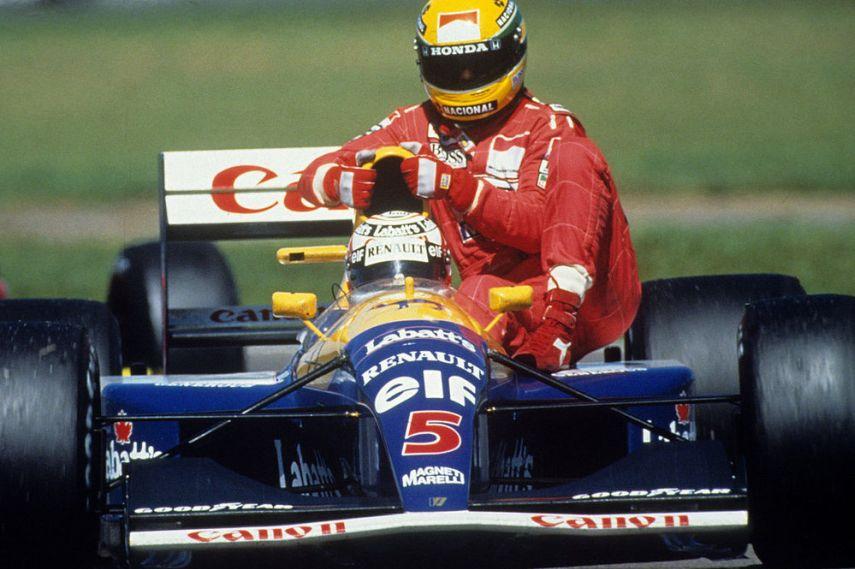 Mansell drives Senna in 1991.