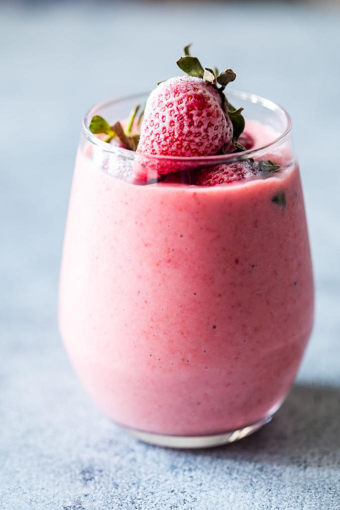 Cocktail with yogurt and strawberries .