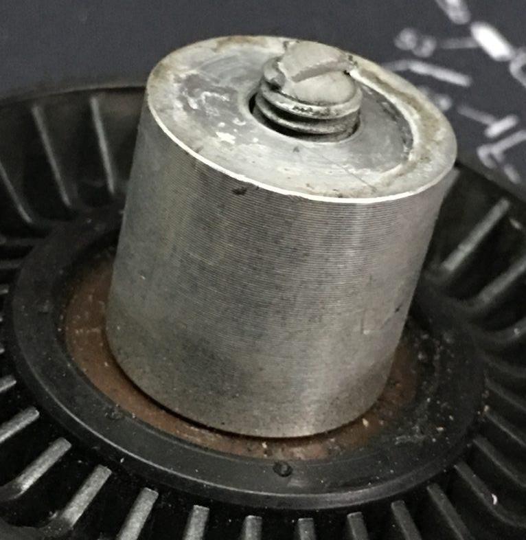 unscrew the hub bolt