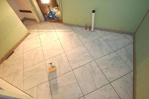 where to start laying tiles on the floor in the bathroom