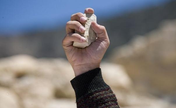 Побиение камнями
