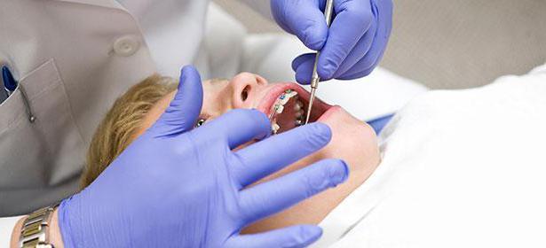 сверхкоплектные зубы причины