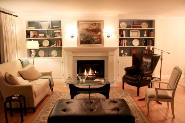 камин в интерьере гостиной фото современный стиль
