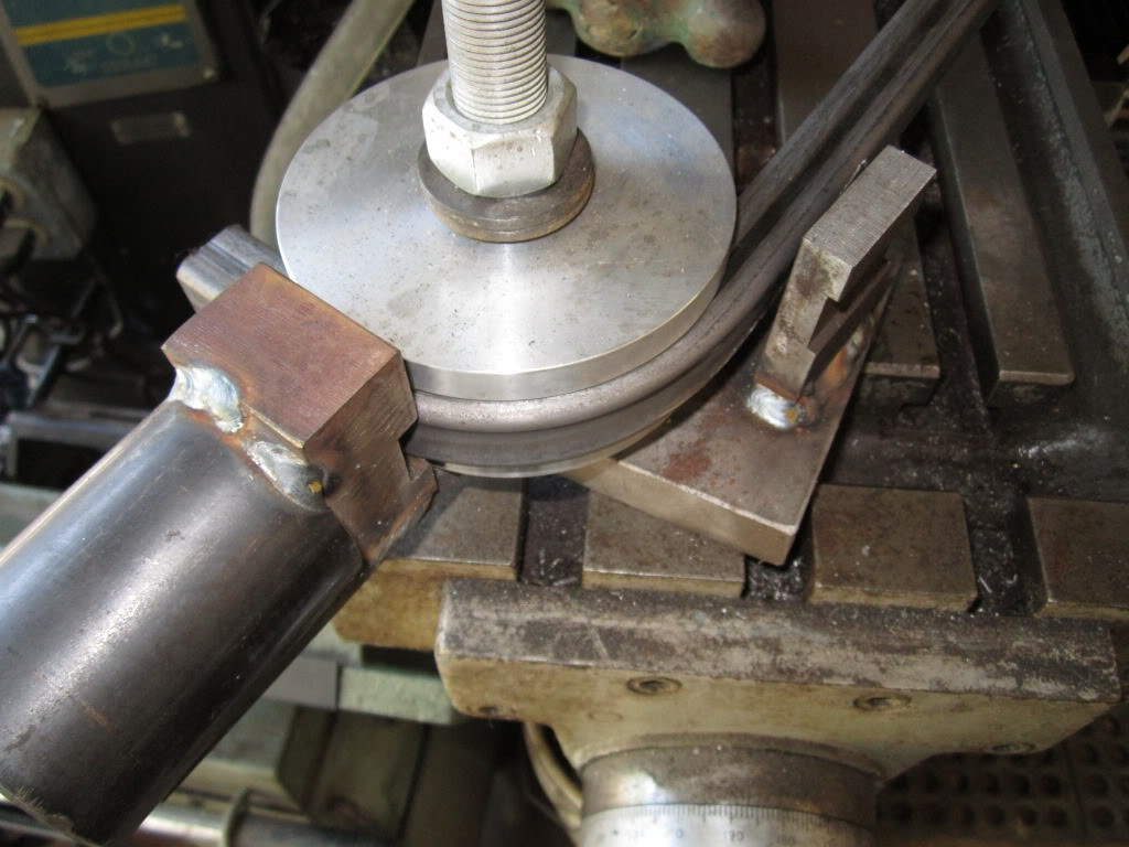 Pipe bender with pinch roller