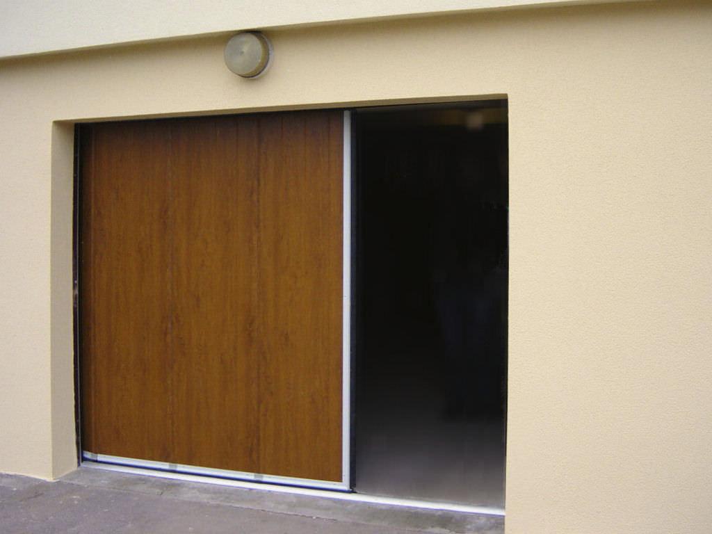 Раздвижные двери гаража своими руками 10