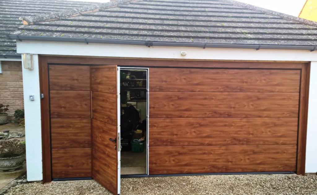 Wooden garage door with door