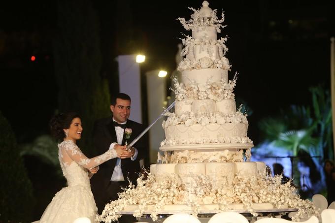 Bride and groom share a huge cake