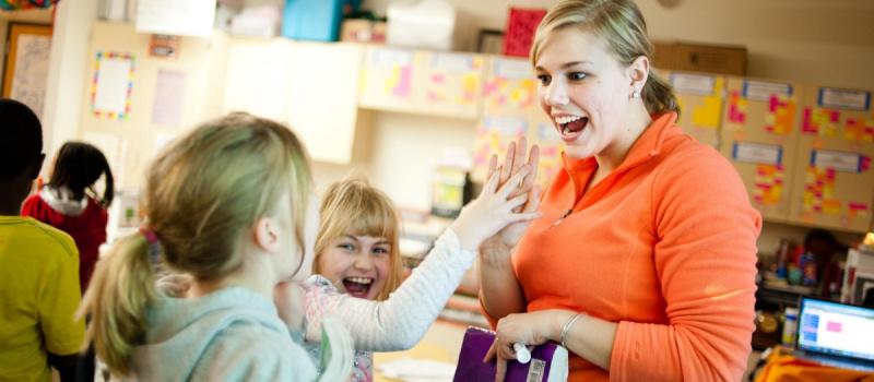 teacher smiles to students