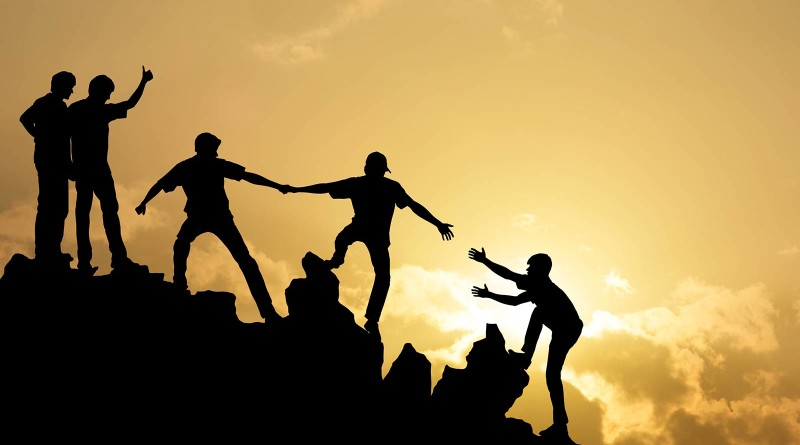 people help each other climb the mountain