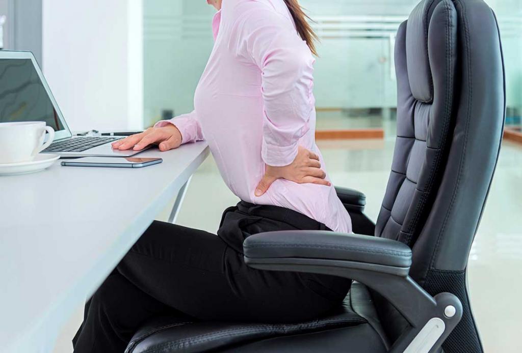 болит спина у офисного работника