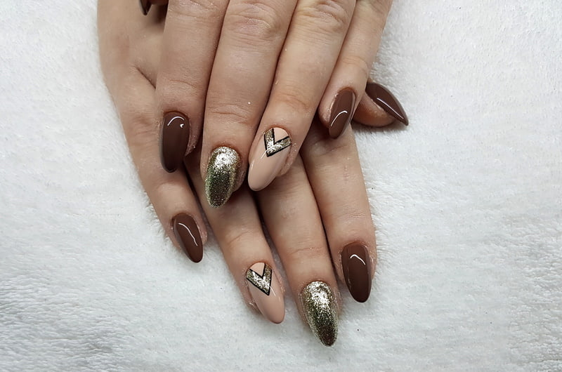 brown manicure with geometric pattern