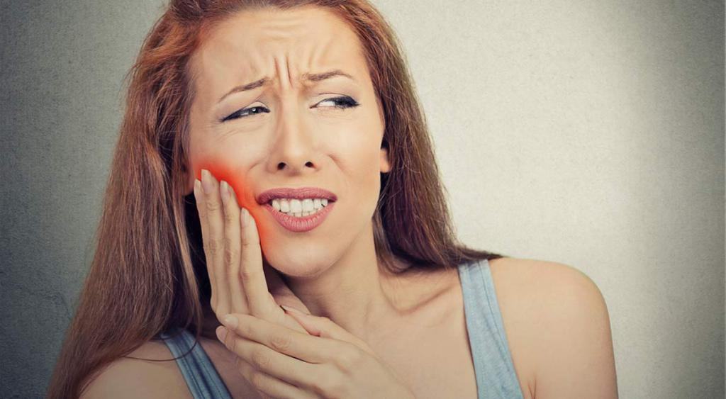 it is painful to open your mouth after tooth extraction