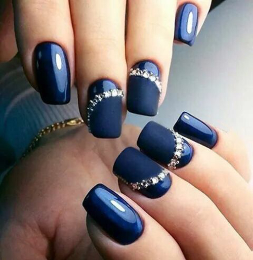 blue manicure with rhinestones